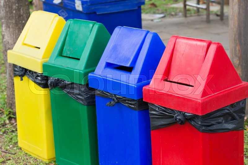 Stock image of 'Colorful of recycle bins in the garden'