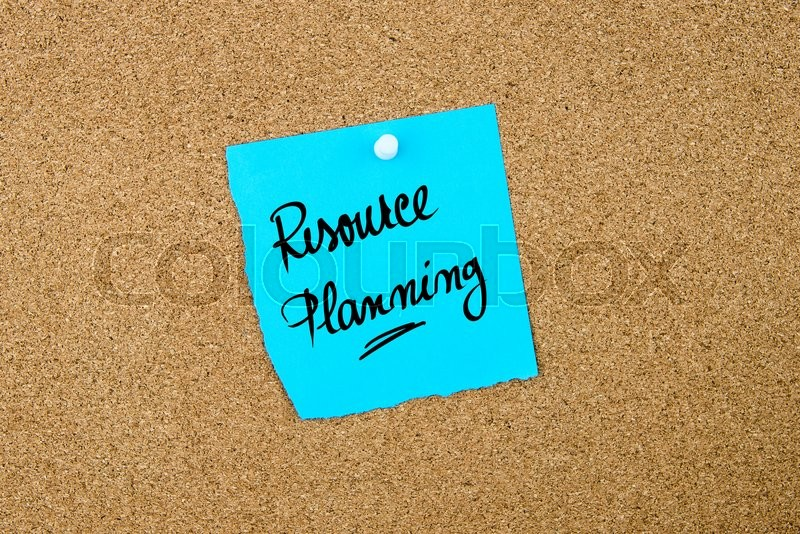 Stock image of 'Resource Planning written on blue paper note pinned on cork board with white thumbtacks, copy space available'
