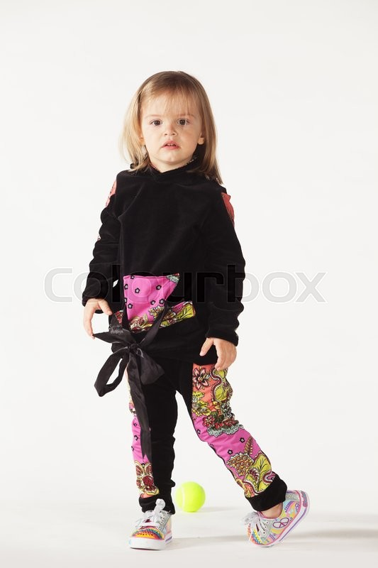 Stock image of 'Little girl in a fashionable clothes isolated on white '
