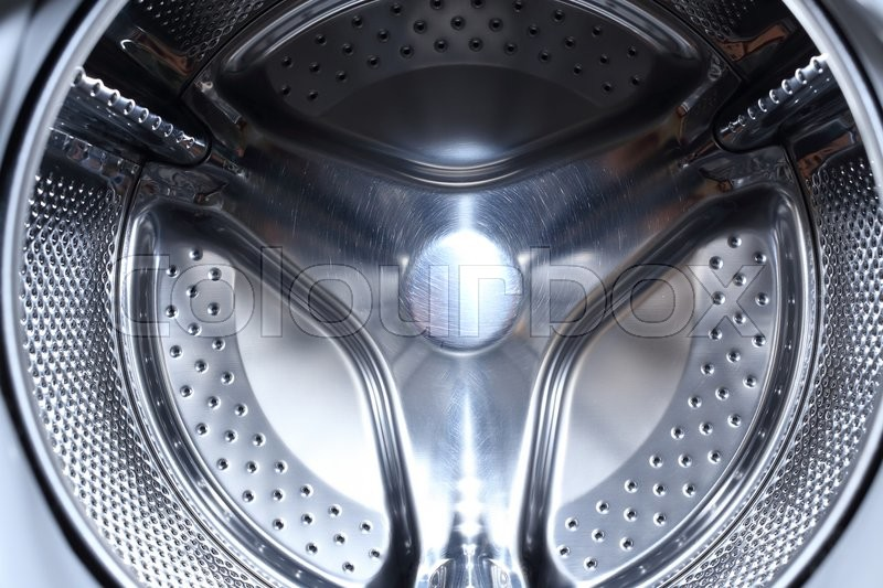 Stock image of 'Closeup image of washing machine, abstract metallic texture background'