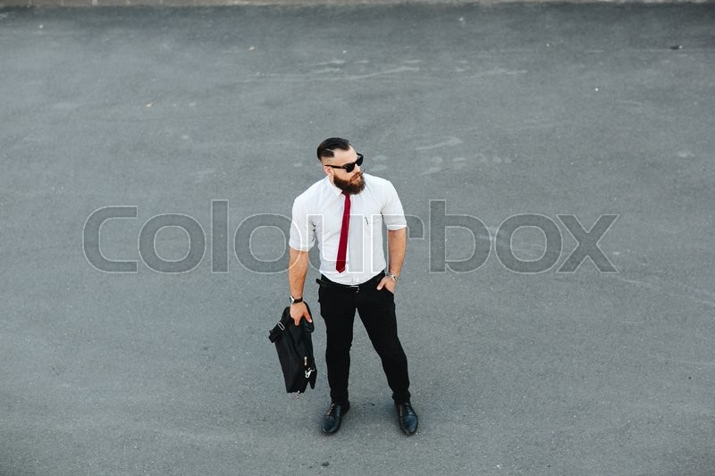 Stock image of 'businessman looking for a partner on the street'