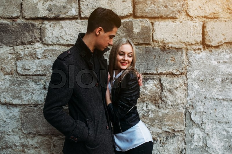 Stock image of 'Photo of a young beautiful couple on the background of the old wall'