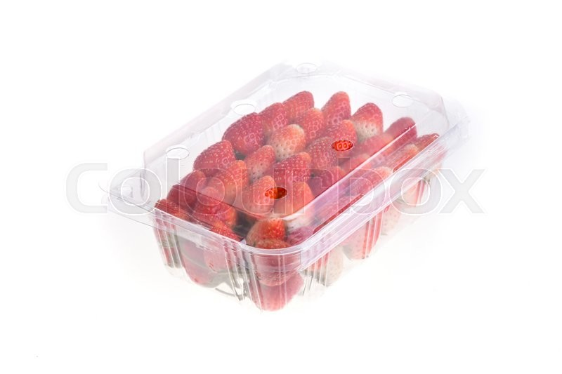 Stock image of 'red ripe strawberry in plastic box of packaging for sale, isolated on white background'