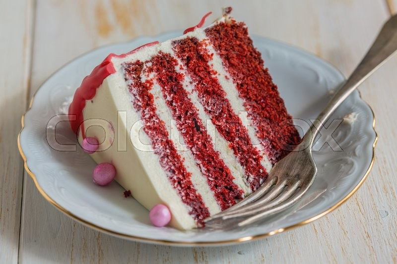 Stock image of 'Plate with a piece of cake Red velvet on a white table.'