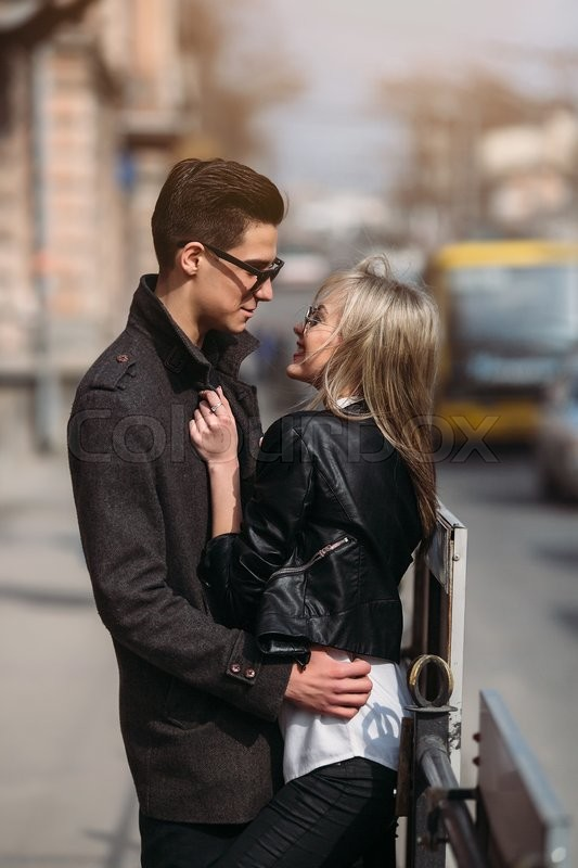 Stock image of 'Photo of a young beautiful couple on busy city street'