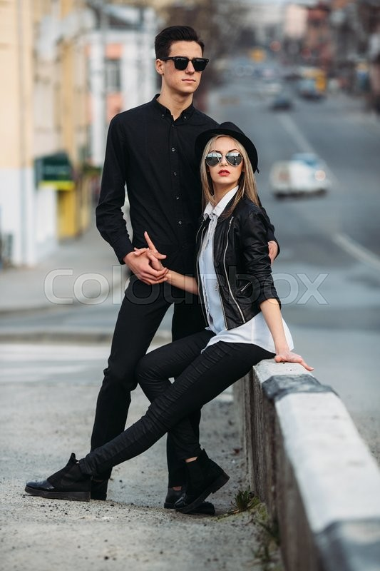 Stock image of 'Photo of a young beautiful couple on the city street'