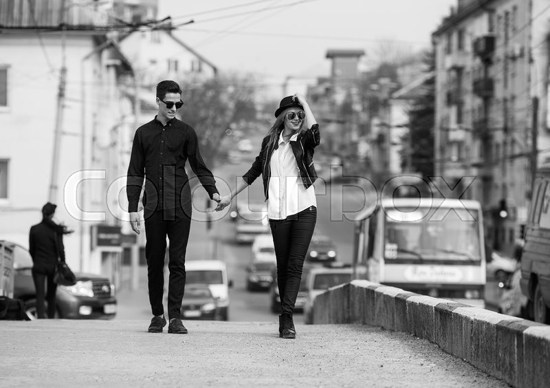 Stock image of 'Young beautiful couple walking on the street'