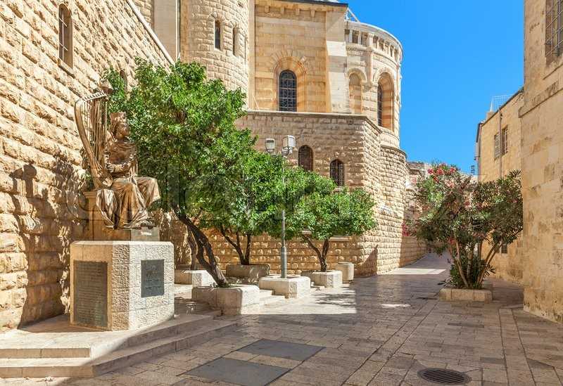 Editorial image of 'JERUSALEM, ISRAEL - JULY 16, 2015: Sculpture of King David playing harp near entrance to his tomb on Mount Zion. This is also the place believed by Christians of the Last Supper of Jesus.'