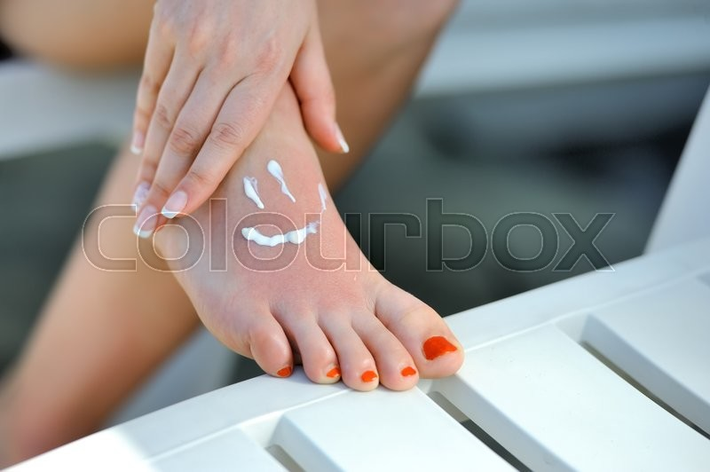 Stock image of 'Care for beautiful woman legs. Smile shape on woman feet'