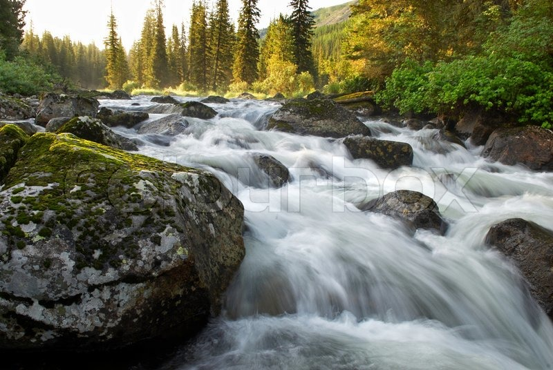 Sunrise and mountain flowing stream, stock photo