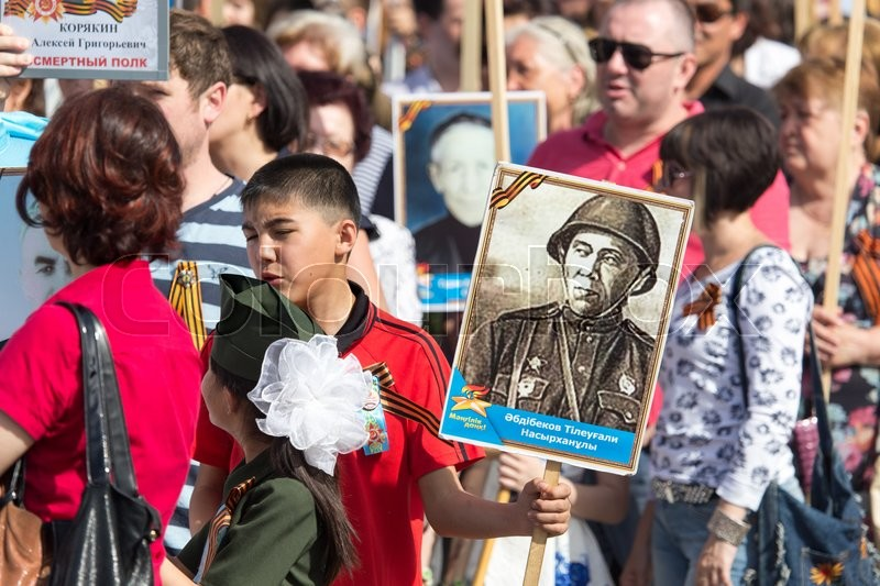 Editorial image of 'Shymkent, KAZAKHSTAN May 8, 2016: Immortal regiment .Den Victory in memory of the soldiers of the Great Patriotic War. Victory Day celebration in the city of Shymkent, Kazakhstan, May 8, 2016'