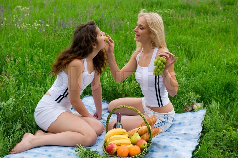 Two Beautiful Girls Blonde And Brunette In White Suits