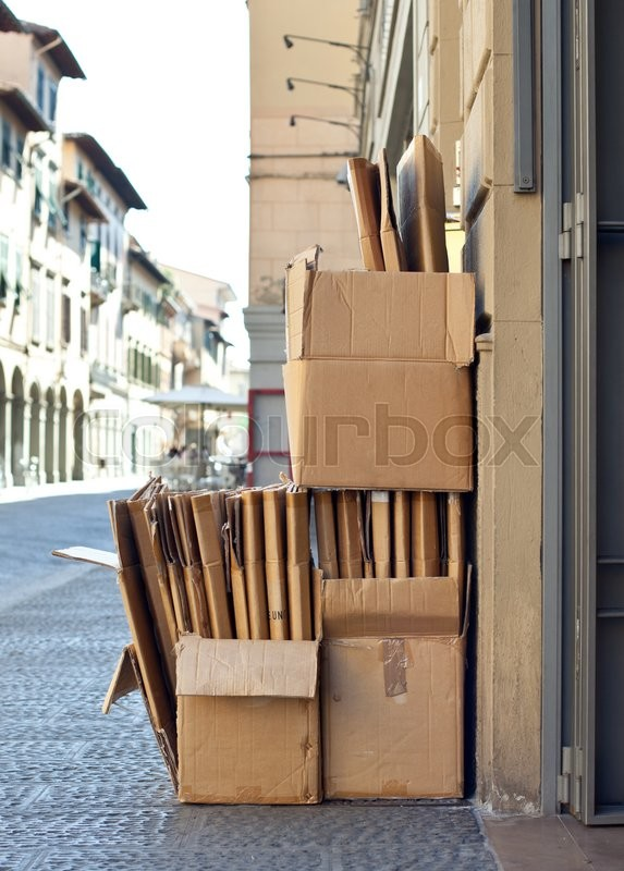 Stock image of 'Cardboard on the street outside a store pending collection for recycling.'