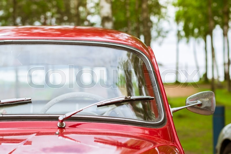 Stock image of 'KOTKA, FINLAND - JUNE 14, 2014: Red Skoda Felicia coupe parked on shore of Finnish gulf. Festival and exhibition of retro-club of the Czech automaker. Island Mussalo, Kotka, Southern Finland, Suomi'