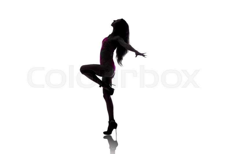 Stock image of 'Profile silhouette of attractive young woman wearing pink sportswear dancing. Fit sporty girl warming up, working out and jumping with her long hair flying. Studio image. White background'