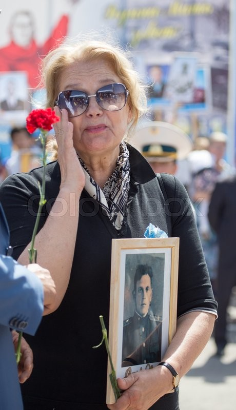 Editorial image of 'Shymkent, KAZAKHSTAN May 8, 2016: Irina Alferov People's Artist of Russia in the Immortal regiment. Victory Day celebration in the city of Shymkent, Kazakhstan, May 8, 2016'