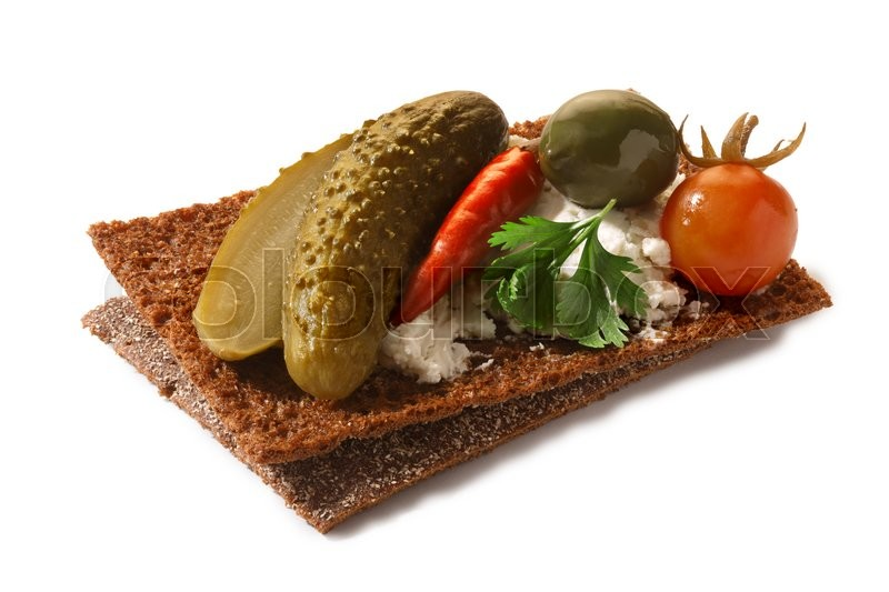 Stock image of 'Bread crisp (crispbread open-faced sandwich) with pickled vegetables , soft cream cheese and cilantro leaves. Clipping paths for both crisp and shadow, infinite depth of field'