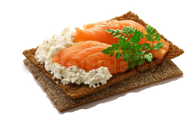 Stock image of 'Bread crisp (crispbread open-faced sandwich) with salmon, soft cream cheese and fresh chervil. Clipping paths for both crisp and shadow, infinite depth of field'