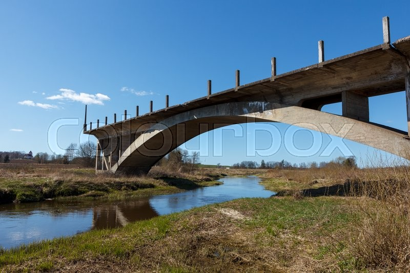 Stock image of 'An old and unfinished bridge over a river '