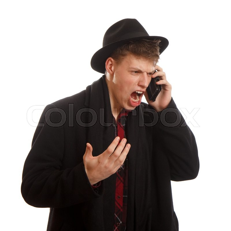 Stock image of 'An young adult screaming on the phone'