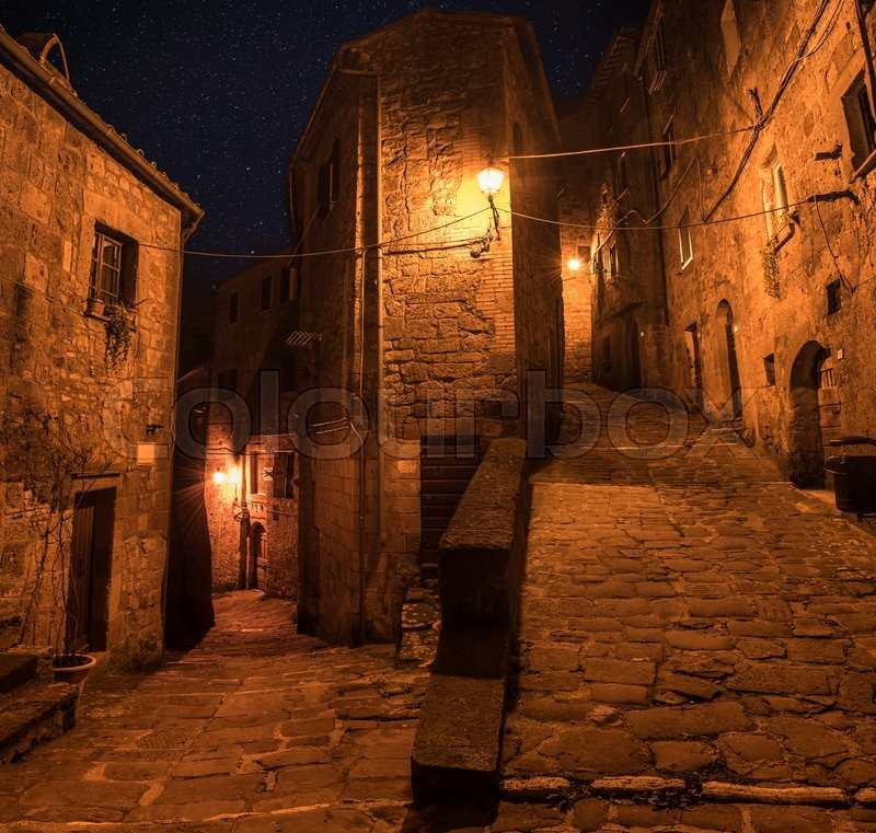 Stock image of 'Street of ancient medieval tuff city Sorano at night  - travel european background'