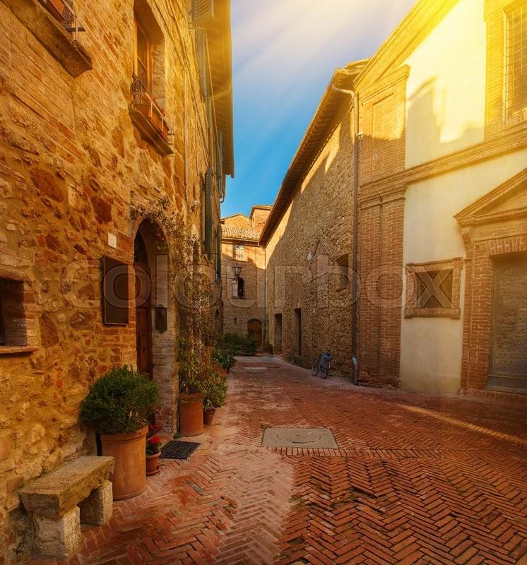 Stock image of 'View of the ancient old european city. Street of Pienza, Italy. Sunny travel vintage background with copy space.'