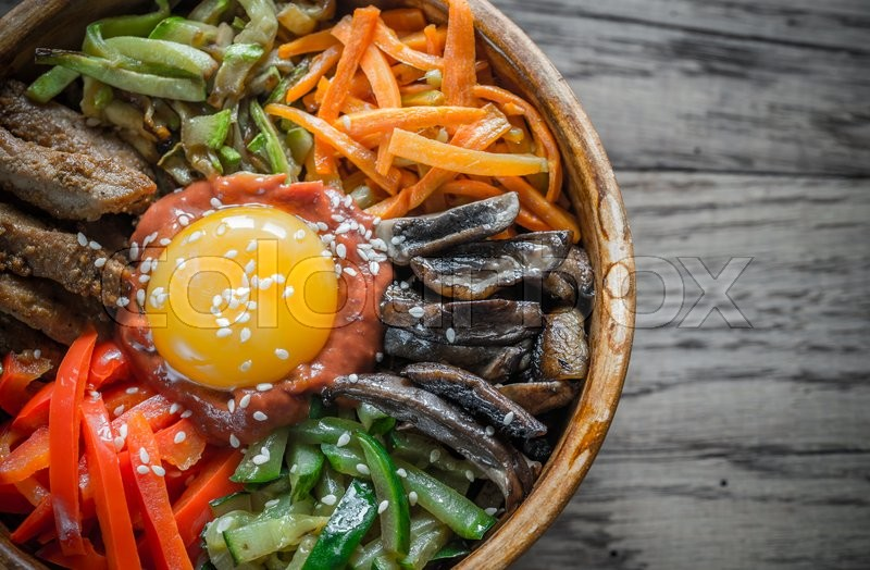 Stock image of 'Bowl of bibimbap on the wooden table'