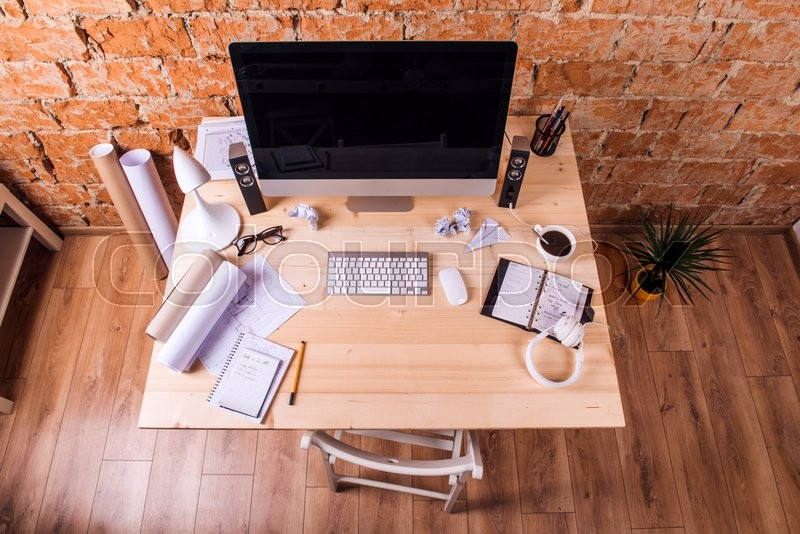 Stock image of 'Desk with various gadgets and office supplies. Computer, smart phone, tablet and other devices and stationery around the workplace.'