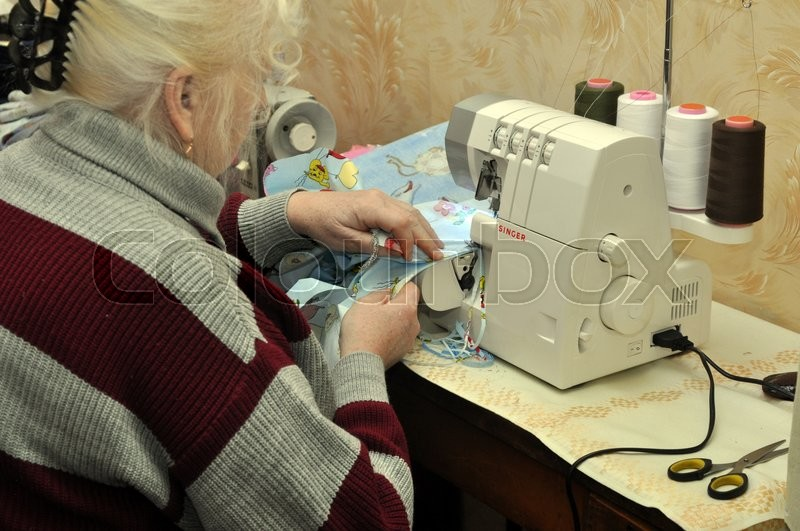 Stock image of 'An old woman sewing'