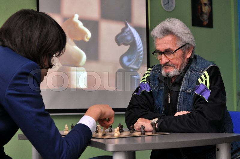 Stock image of 'Chess game between zoung and old man'