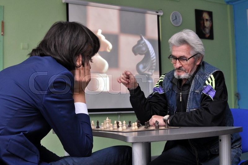 Stock image of 'A tournament between an old man and a boy'