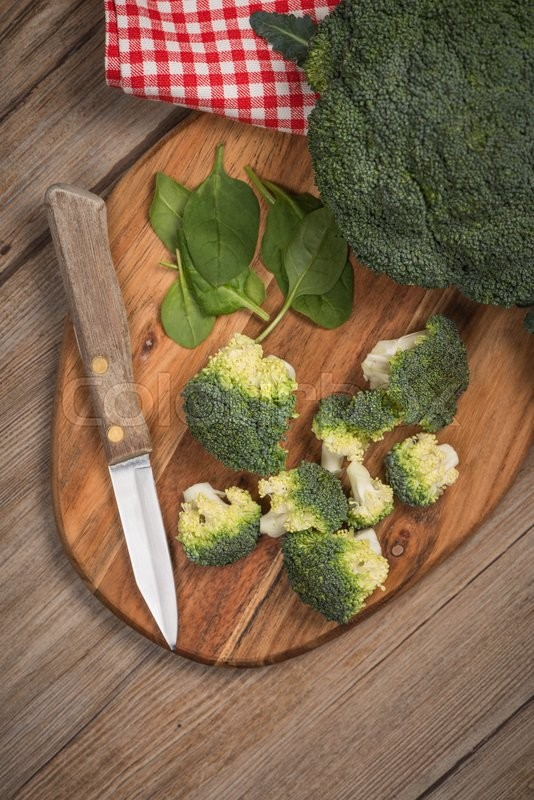 Stock image of 'Green broccoli on wood table'