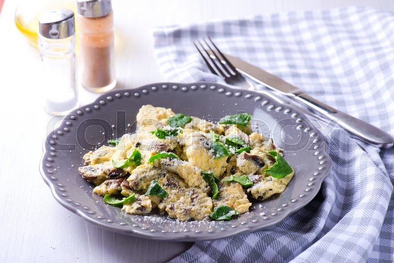 Stock image of 'Spinach mushroom frittata on the wooden table'