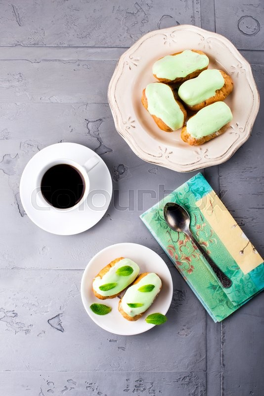 Stock image of 'Breakfast with mint eclairs and coffee cup. Top view'