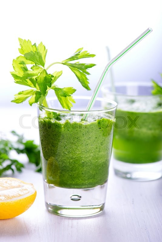 Stock image of 'Detox green smoothie with avocado, onions, spinach and celery'