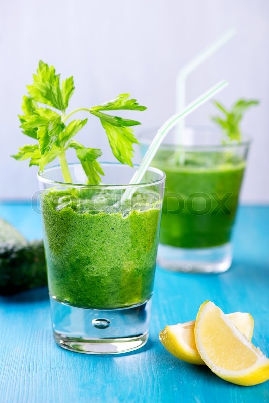 Stock image of 'Detox smoothie with onions, celery, spinach in two glasses'