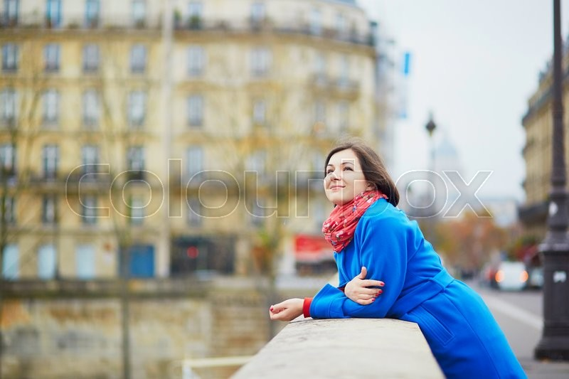 Stock image of 'Beautiful young tourist in Paris on a fall or spring day'