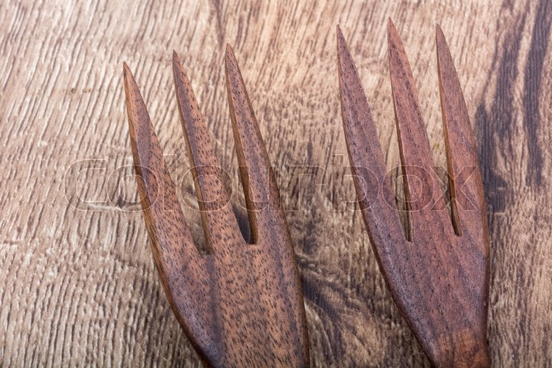 Stock image of 'Wooden forks on a brown wooden background'