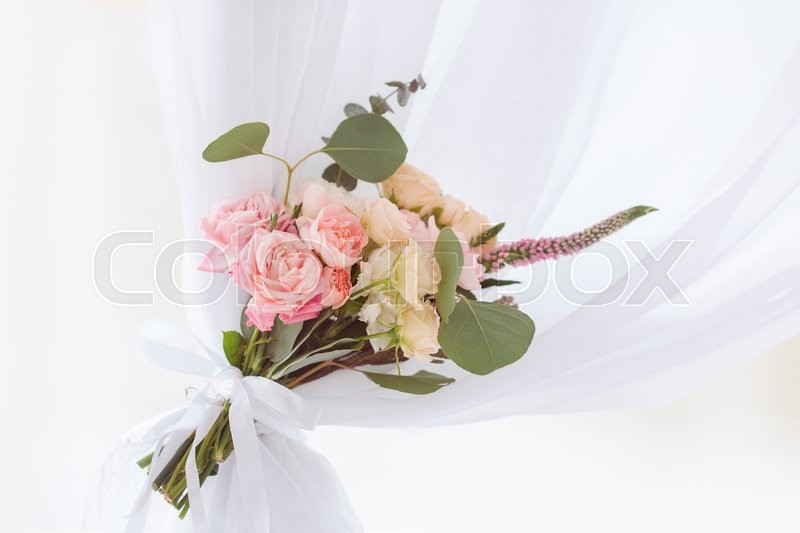 Stock image of 'Pink and orange flowers, details of wedding decorations on sunny day'