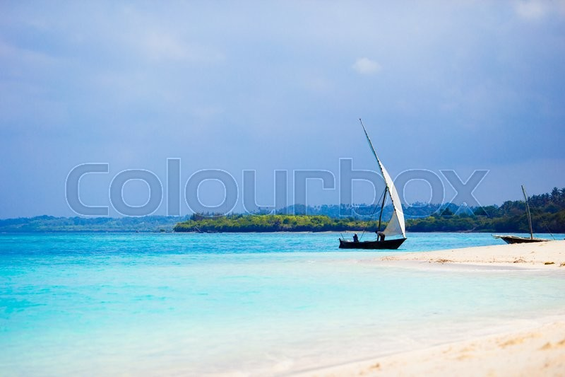 Stock image of 'Old wooden dhow on white beach in the Indian Ocean'