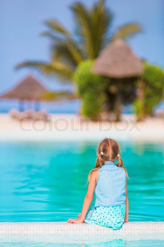 Stock image of 'Little happy adorable girl in outdoor swimming pool'