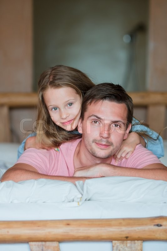 Stock image of 'Father and adorable little girl having fun at home'
