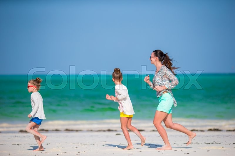 Stock image of 'Young beautiful family have fun on beach vacation'
