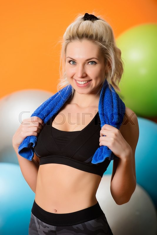 Stock image of 'Young beautiful woman works out in the gym'