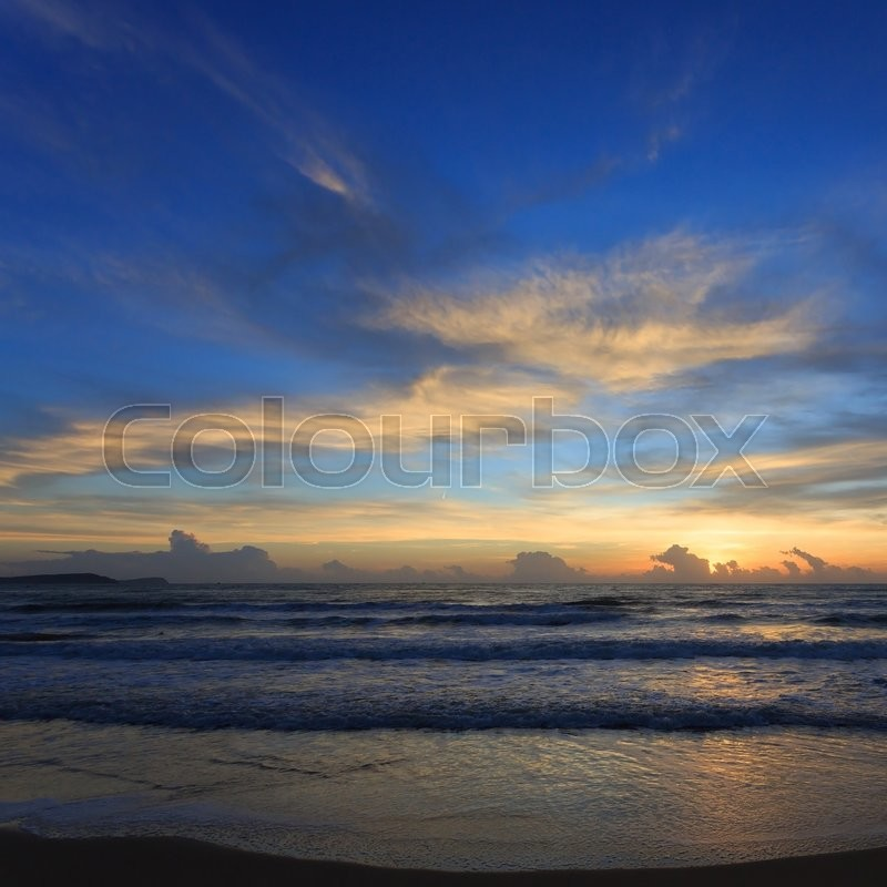 Stock image of 'Sunset dramatic sky with colorful cloud on the beach, summer background'