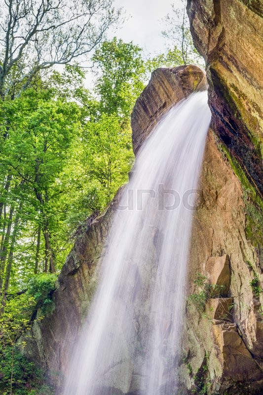 Stock image of 'One of Indiana's tallest waterfalls, Williamsport Falls, plunges over a large sandtone cliff in Warren County.'