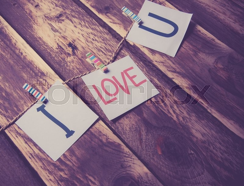 Stock image of 'Valentines day card,words of love on wood background,vintage color toned image'