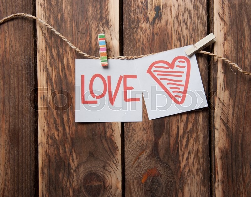 Stock image of 'Valentines day card with hearts and words of love on wood background'