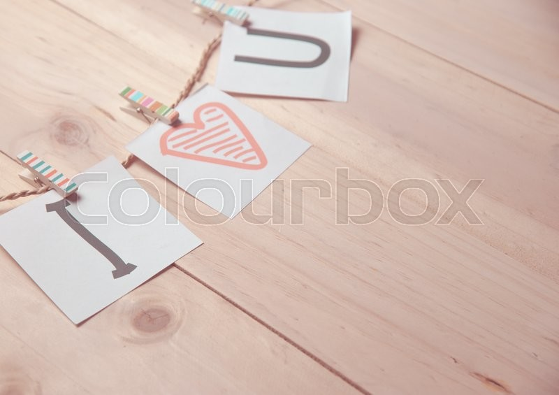 Stock image of 'Valentines day card with hearts and words of love on wood background,vintage color toned image'
