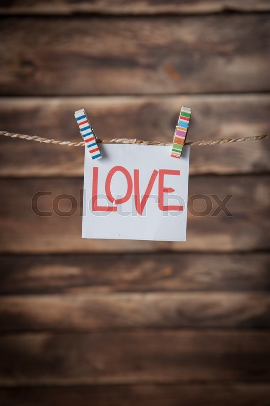 Stock image of 'Valentines day card,words of love on wood background'